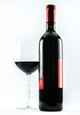 Composition of an exquisite bottle of wine and an elegant glass of red wine on a white background Royalty Free Stock Photo