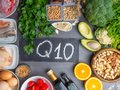 Composition with food contains coenzyme Q10, antioxidant, produce energy to cell, products against free radicals, and supports Royalty Free Stock Photo