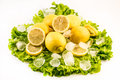 Composition of fresh lemons and ice on salad on white background Royalty Free Stock Photo