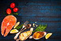 Composition with fresh salmon, herbs, parmesan and spices. Food background Royalty Free Stock Photo