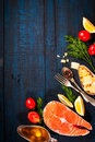 Composition with fresh salmon, herbs, parmesan and spices. Food background. Space for text Royalty Free Stock Photo