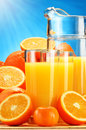Composition with glasses of orange juice and fruits Stock Image