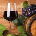 Still life, goblet of red wine, grapes and barrel Royalty Free Stock Photo
