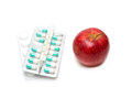 Composition with medicaments and apple selective focus image of Stock Photography