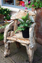 Composition of old wooden chair and plants Royalty Free Stock Images