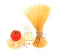 Composition of pasta tomato cheese oil pepper bunch spaghetti fresh tomatoes bottle and Stock Photo