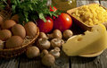 Composition of pasta, vegetables and cheese. Stock Photos