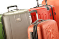 Composition with polycarbonate suitcases over white Royalty Free Stock Image