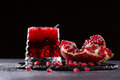A composition of a pomegranate drink and cut garnet on a black background. Healthful and fresh red cocktails. Summer Royalty Free Stock Photo