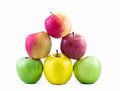 Composition - pyramid of three types of apples on a white background - green, yellow and red - still life Royalty Free Stock Photo