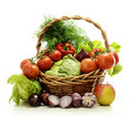Composition with raw vegetables and wicker basket Royalty Free Stock Photo