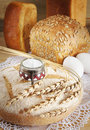 Composition with round rye loaf and salt Royalty Free Stock Image