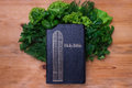 Composition with salad and bible Royalty Free Stock Photo