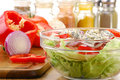 Composition with salad bowl and salad ingredients Royalty Free Stock Photo