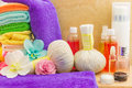 Composition with spa products: towels, pouches, flowers orchid, Royalty Free Stock Photo