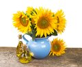 Composition with sunflowers and sunflower oil on Royalty Free Stock Photo