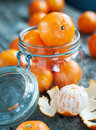 Composition with tangerines in a jar rural style russian tradition to eat this fruits on christmas Royalty Free Stock Photos