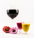Composition of two cocktails - yellow and pink and flowers on a white background Royalty Free Stock Photo