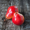 Composition with two pears on the dark wooden table square imag image Stock Image