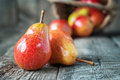 Composition with two red pears on the dark wooden table Royalty Free Stock Photo