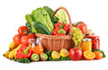 Composition with variety organic vegetables and fruits in wicker basket on white Stock Image