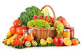 Composition with variety organic vegetables and fruits in wicker basket on white Stock Photo