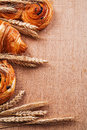 Composition of wheat ears bakery goods on oaken Royalty Free Stock Photo