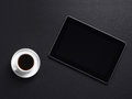 A composition of a white coffee cup and a tablet pc Stock Images