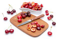 Composition with whole and pitted cherries isolated on white Stock Photography