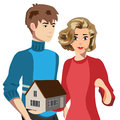 Composition wife and husband holding small house