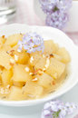 Compote of apples and pears with vanilla in a bowl closeup Royalty Free Stock Images