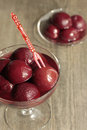 Compote of plums in a glass jar and on a glass plate Royalty Free Stock Photo