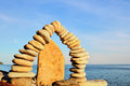 Compound of pebbles stones laid out in the form a arch on the sea coast Stock Image