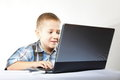 Computer addiction child with laptop notebook boy white background Stock Photo