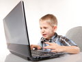 Computer addiction emotional child boy laptop notebook playing games isolated white background Stock Images