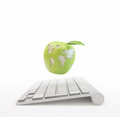 Computer and an apple with the world map Royalty Free Stock Photo
