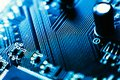 Computer board capacitors blue color close-up