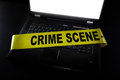 Computer crime scene laptop with tape across it Royalty Free Stock Image