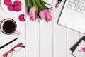 Computer, glasses, coffee and accessories in pink color on white Royalty Free Stock Photo