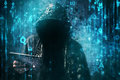 Computer hacker with hoodie in cyberspace surrounded by matrix code Royalty Free Stock Photo
