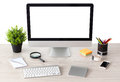 Computer with isolated screen stands on the table in office phone and watch Royalty Free Stock Photography