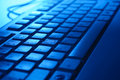 Computer keyboard in blue light Royalty Free Stock Photo