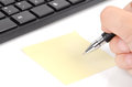 Computer keyboard and notepaper with pen Royalty Free Stock Photos