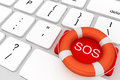 Computer Keyboard with red SOS button and lifebuoy Royalty Free Stock Photo