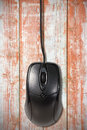 Computer mouse on the old wooden planks black background Royalty Free Stock Images