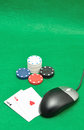 A computer mouse with poker chips and playing cards Royalty Free Stock Photo