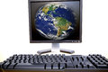 Computer planet earth on the screen and keyboards on white Royalty Free Stock Image