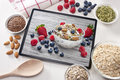 Computer Tablet Cereal Berries Nuts Grains Breakfast Royalty Free Stock Photo