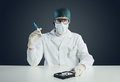 Computer virus concept technical doctor with syringe and hard disk Stock Image