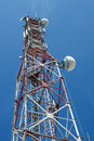 Comunications antena tower communications with blue sky as background Stock Photography
